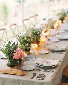 """The guests strolled downhill to a forest clearing where a tent was constructed around a tree. """"We wanted everyone to feel like they were walking into a magical world,"""" says Maureen, who went barefoot for the laid-back reception. Peonies and wild grasses dressed up the tables, while baguettes for sharing fostered a communal atmosphere.After a meal of heirloom vegetables, tagliatelle ragù, and branzino, the newlyweds danced to """"Come Rain or Come Shine"""" by Ray Charles. The party bur..."""