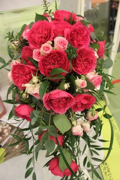 Show stopping cerise pink garden roses in a shower, tear drop shaped bouquet. Created by our Head Florist at Isle of Wight Flowers, Charlotte King. http://www.isleofwightflowers.co.uk/