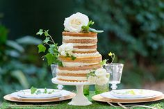 Natural Naked Wedding Cake with Ivy and White Roses | Emily Chappell Photography | Bohemian Garden Wedding Inspired by Fine Art