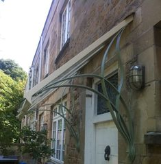 Andy designed this unique canopy for a house on Lansdown in Bath. The intersecting design was inspired by a pretty arts and crafts style stained glass panel above the door. The metalwork was finish...