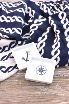 Rope towels would be cute, but probably more expensive - solid navy, yellow & white would work.