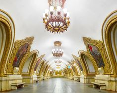 """For two weeks last year, Canadian photographer David Burdeny spent his nights 200 feet underground, shooting the surreal opulence of the Moscow Metro. With their ornate chandeliers, marble walls, bronze columns, and intricate mosaics, these railway stations have been likened to an """"artificial underg"""