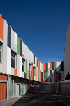 French studio Block Architects have completed a building Nantes, France, clad in multi-coloured stripes derived from the aesthetics of vegetable farms. Called Bottière Chenaie, the block is constructed on land formerly used for farming vegetables. The concrete building is clad in vertical, corrugated stripes of colour and comprises housing, public facilities and a school. The More