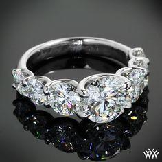 A stunning masterpiece, this beautiful Custom Diamond Engagement Ring features a graduating row of A CUT ABOVE® Hearts and Arrows Diamonds leading to a brilliant 1.60ct A CUT ABOVE® Hearts and Arrows Diamond More