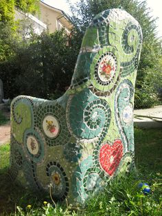 Mosaic chair ~~ Started with a regular metal garden chair, covered it with chicken wire and concrete and then added the mosaics. www.waschbear.com/mosaic-chair-tutorial.php