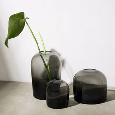 The Troll Vase by Menu is an innovative vase that takes its name from a famous painting by the Norwegian artist Theodor Kittelsen, which depicts a mythological water spirit rising from the dark waters of a forest pond