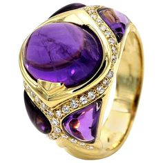 Amethyst Diamond Gold Cocktail Ring - One of a kind ring. The Amethyst cabochon has been custom cut to fit the design of the ring. Details: Diamonds: 0.34 carats - F VVS-VS Amethyst: 7 carats French Hallmark $4,623.00