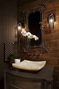 chocolate brown guest bath - love the sink, flooring on wall, wall-mounted faucet, sconces