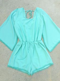 """Beautiful romper features 3/4 fluttering sleeves, gathered waist and crochet hem, fully lined. Feminine and so easy to dress up or down. Made with love in the USA. Polyester. Length: 32"""""""