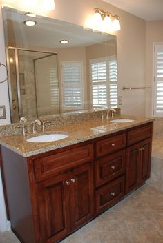 granite counters in bathroom with tile floor. Great colors