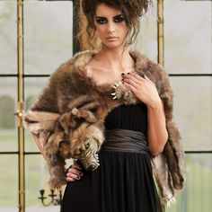 Get wrapped up in this season's most legendary Halloween accessory: the fashion-forward Werewolf Wrap. Transform your look in an instant, with our designer    werewolf wrapped around your shoulders. Faux fur wrap design features four distinctively shaped paws with felt claws, a plush tail, a green-eyed carved    resin face, gray satin lining and an adjustable closure. It's easy to wear and the perfect way to transform jeans and t-shirt or a little black dress into    a bewitching costume....