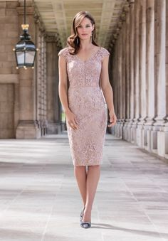 Endlessly elegant, the carefully layered lace adds a beautiful texture to the refined shape. The shimmer twill jacket is cut to complement and lined with careful beads for a touch of understated glamour. The dusty pink colour is the perfect choice for a Spring/Summer ceremony. The expertly designed hat by John Charles millinery completes the look.