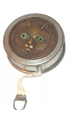 Vintage German Metal Tape Measure with Cat Face on top with Green GlassEyes.