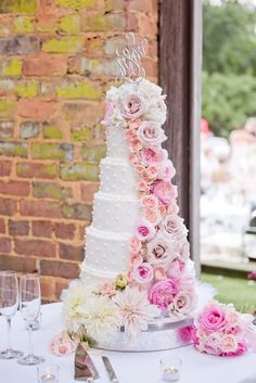Six-Tier Wedding Cake with Blush Flower Cascade | Edge Design Group https://www.theknot.com/marketplace/edge-design-group-atlanta-ga-770104 | 54 Event Planning and Design | Victor Villatoro