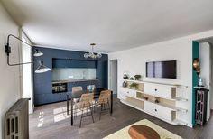 Cuisine noire architecture intérieur, Projet Batignolles , Agence Transition Interior Design, Carla Lopez Margaux poignée cuivre bibliothèque sur mesure poignée étoile chaise osier béton ciré