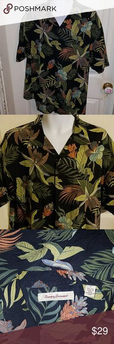 Tommy Bahama Short Sleeve Casual Shirt Large This is a large short sleeve casual shirt by Tommy Bahama. The chest is 24 inches and length is 34 inches. Tommy Bahama Shirts Casual Button Down Shirts