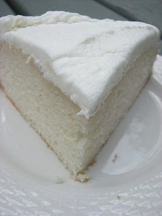 White Almond Cake: 1 (18.25 ounce) package white cake mix,  1 cup all-purpose flour,  1 cup white sugar,  3/4 teaspoon salt,  1 1/3 cups water, 1 cup sour cream,  2 tablespoons vegetable oil,  1 teaspoon almond extract,  1 teaspoon vanilla extract,  4 egg whites