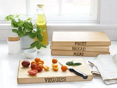 These hand-stamped cutting boards look great stacked on your kitchen counter (not to mention their practicality)