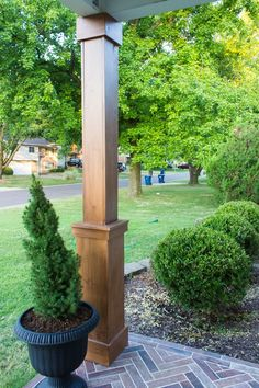 DIY Craftsman Style Porch Columns - Shades of Blue Interiors - - How to wrap existing porch columns in stained wood and build a craftsman style base unit to add character and curb appeal to your front porch. Front Porch Posts, Front Porch Columns, Farmhouse Front Porches, Porch Column Wraps, Porch Roof, Craftsman Style Porch, Craftsman Columns, Craftsman Front Porches, Farmhouse Style