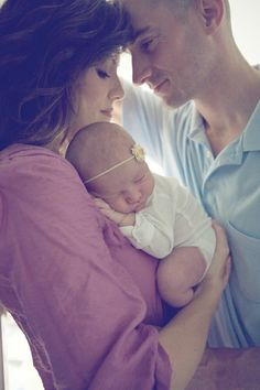 Beautiful parents and baby pose