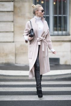 An oversize coat with a turtleneck and coated jeans.