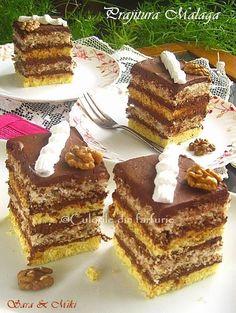 Prajitura Malaga este o prajitura cu bezea, nuca, ganache de ciocolata, deci un adevarat rasfat. Am vazut reteta pe un site-ul online de comenzi. Cum denumirea era asemanatoarea cu a Tortulu… Malaga, Romanian Desserts, Different Cakes, Food Cakes, Sweet Cakes, Cheesecakes, Tiramisu, Waffles, Cake Recipes