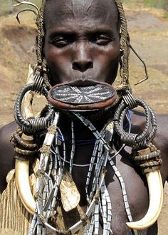 Ethopia - Mursi Aesthetics II by david schweitzer, via Flickr. This is the only tribe in Africa that wears these lip plates.