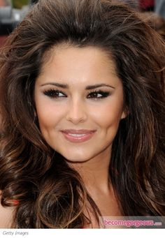The X Factor judge is ready to conquer the US with her inspiring look and talent. Cheryl Cole flaunts her sultry smokey eye makeup crowned with super-glamorous false lashes. Cheryl's glossy lips stay in the background to keep the spotlight on her glimpse.