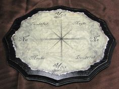 A divination board for use with a pendulum