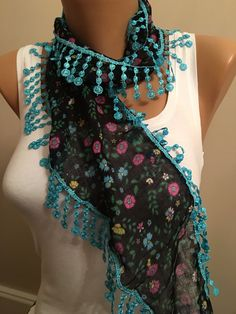 A personal favorite from my Etsy shop https://www.etsy.com/listing/269749503/turquoise-black-floral-scarf-lace-scarf