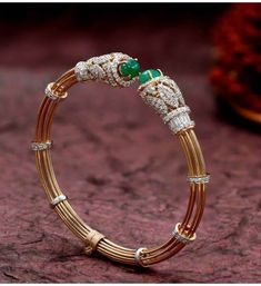 Yellow gold bracelet with glossy twin emeralds and sparkling diamonds is an ideal choice for parties. Gold Bangles Design, Gold Jewellery Design, Gold Bracelet Indian, Indian Gold Bangles, Diamond Bracelets, Diamond Jewelry, Gold Bangle Bracelet, Diamond Brooch, Gold Jewelry Simple