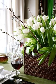 Floral Arrangement ~This spring centerpiece contains one bundle of pussy willows, white tulips