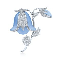 Diamond and chalcedony bluebell brooch in 18K white gold A beautiful symbol of everlasting love, the delicate bluebell is created from brilliant diamonds and lustrous chalcedony