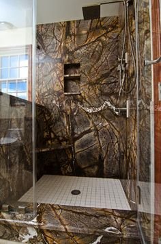 Rainforest Brown Granite vanity, tub surround, and shower wall in bathroom. LOVE!!!