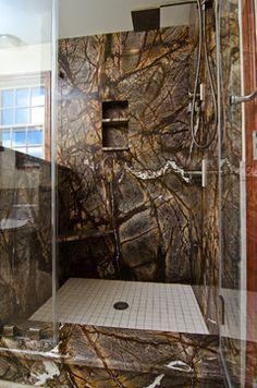 Rainforest Brown Granite vanity, tub surround, and shower wall in bathroom. LOVE!!!