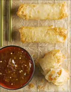 Homemade Egg Rolls - Don't shy away, they're actually easy to make.  I would SO add shrimp to this filling.  There is also a duck sauce recipe on this site.  :)