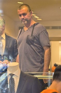 George Michael and his boyfriend Fadi Fawaz go shopping at Armani and several other boutiques while on holiday.