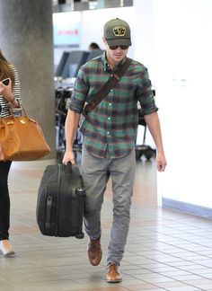 Zac Efron touches down in Los Angeles, California on September 15th, 2012.