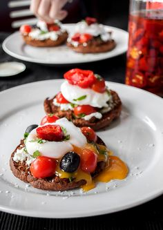 Poached Duck Eggs on Light Multi-Seed English Muffin with tomatoes, coriander and olives