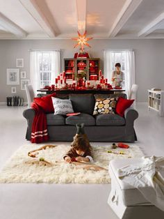 Like the gray couch, white carpet, red throw pillows and accents