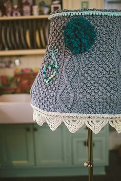 Knitted Lampshade. No pattern. Maybe an old sweater and lacey trim would work also.