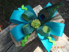 Burlap and peacock Huge hair bow. $7.00, via Etsy.