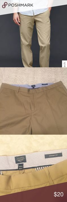 Gap Straight Fit Tailored Khaki Pants Size 38x32 Straight through the leg. Sits low on the waist. Straight leg opening. Straight chambray-lined waistband. Button closure, zip fly. Front slant pockets. Rear button-welt pockets. Excellent condition. GAP Pants Chinos & Khakis