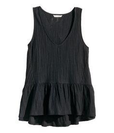 Sleeveless, V-neck top in cotton slub jersey with flounce at hem.