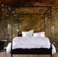 Claire Basler, artist. This is the bedroom of Claire Basler, and the use of her artwork to decorate it sets the tone for both waking and dreaming.