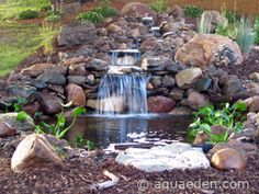 Portfolio of ponds waterfalls streams fountains and for Koi pond builders mn