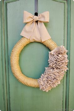 How to make a wreath with rope and a drop cloth. Love the rope; canvas not as much but could be made into rosettes?