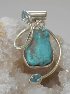 """Handmade natural """"Sleeping Beauty"""" Turquoise gemstone pendant with an organic-shaped center stone adorned with 2 sparkling faceted teardrop-shaped Blue Topaz gemstones, bezel-set in 925-hallmarked Ste"""