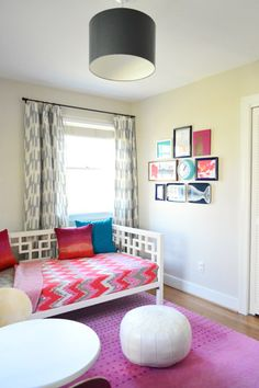 I love the little picture grouping on the wall...need to paint some of SK's white frames a fun color.