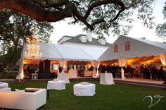 Tents are so safe for outdoor weddings... I really like the idea of the cushioned seats in the lawn